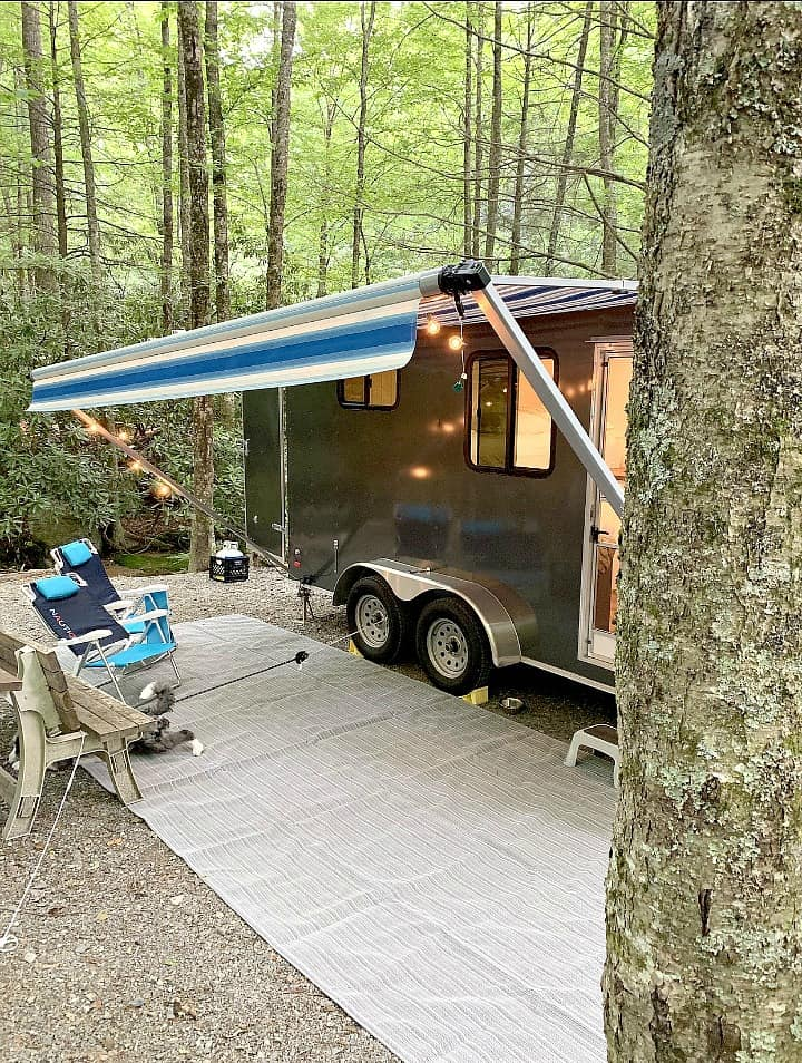 cargo trailer conversion on wooded camping site