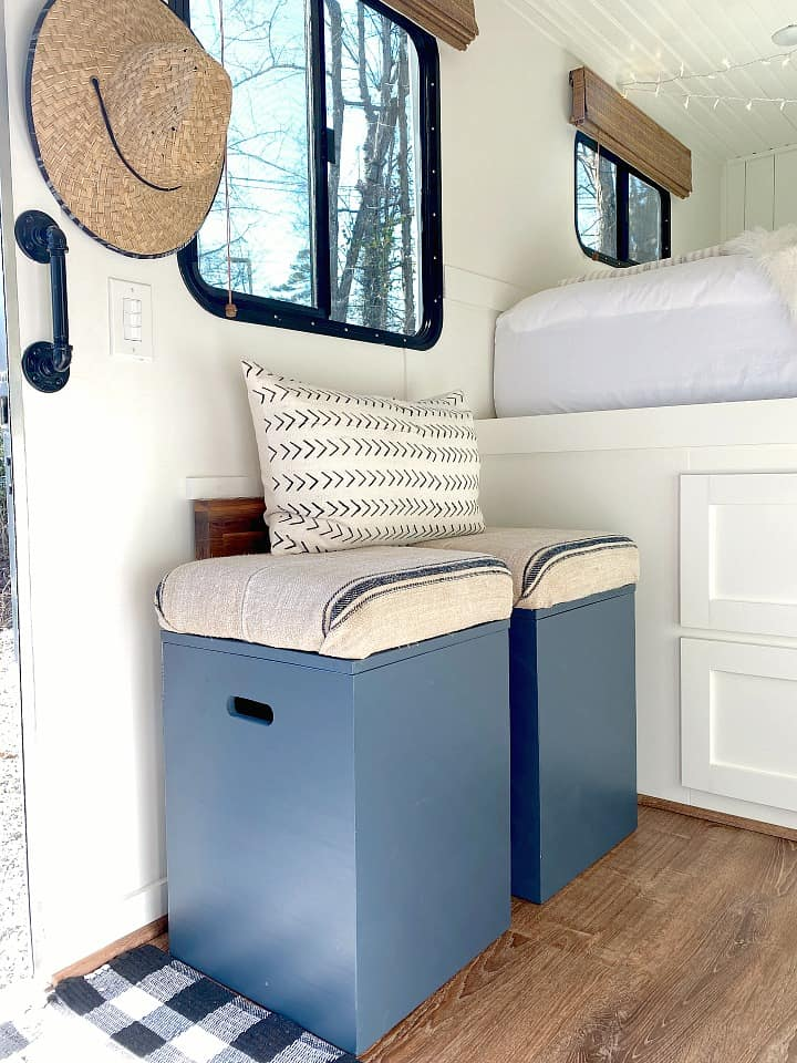 DIY navy storage stools with cushions in small RV