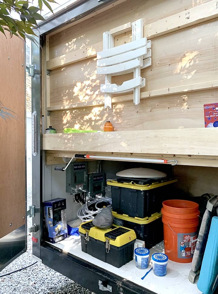 garage area in a small RV with storage and organization ideas