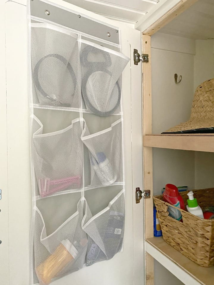 shoe organizer in RV linen closet used for storage of bathroom toiletries