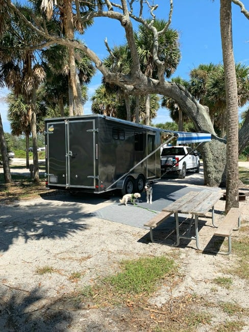 cargo trailer conversion parked in beach campsite