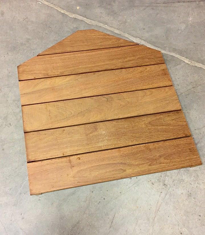 DIY wood shower mat on concrete floor