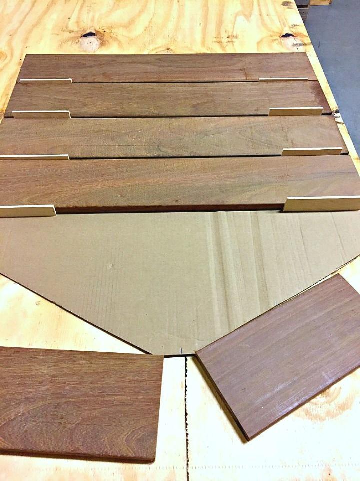 ipe wood planks on cardboard cutout of shower floor