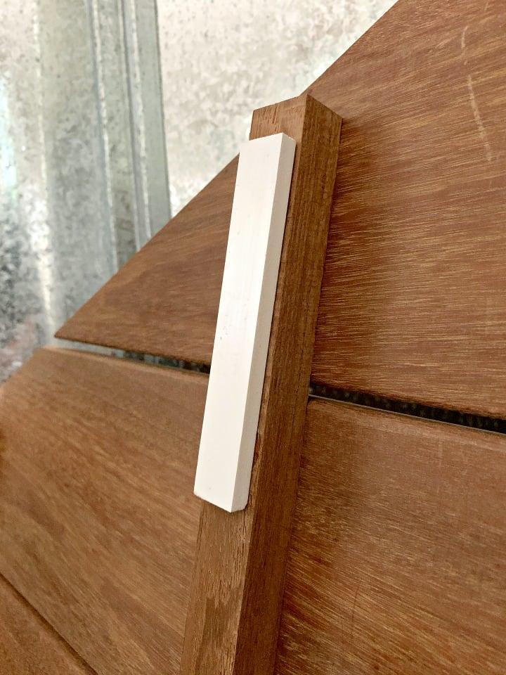 vinyl strip on bottom of ipe wood shower mat