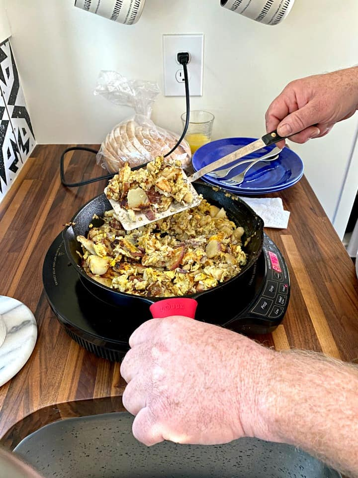 flipping eggs in a camping breakfast skillet