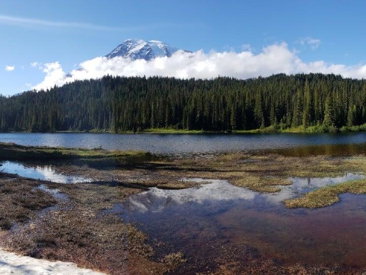 reflection of mount rainier peak in reflection lake