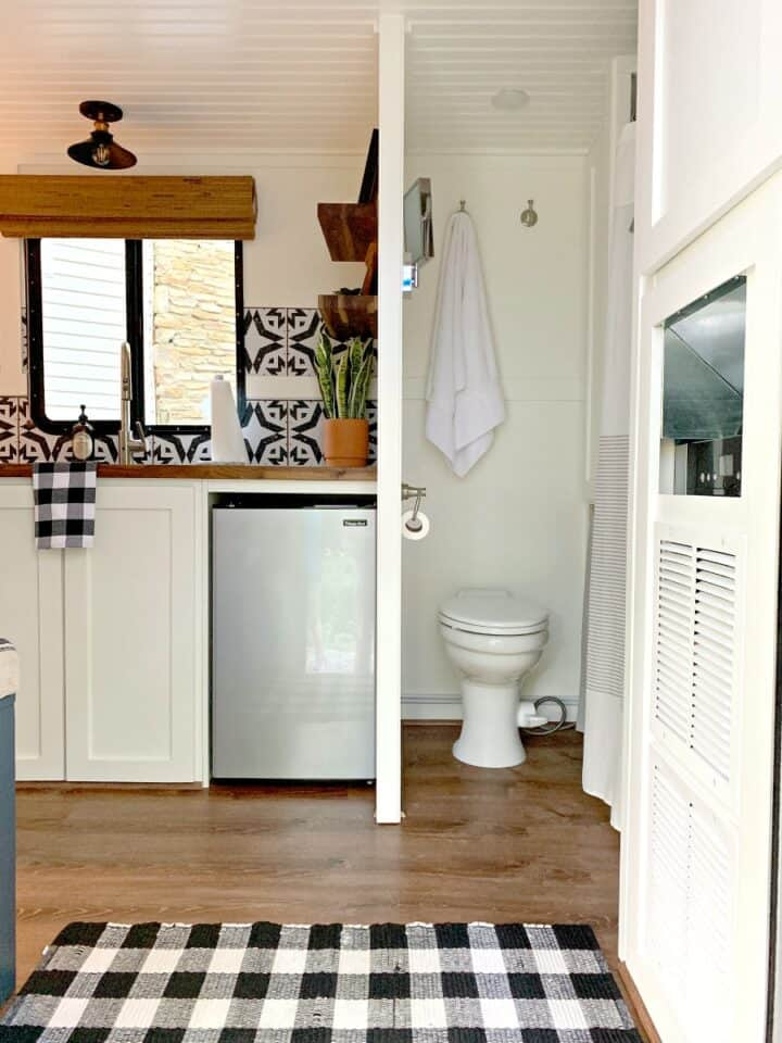 looking at toilet and kitchen from doorway in small RV