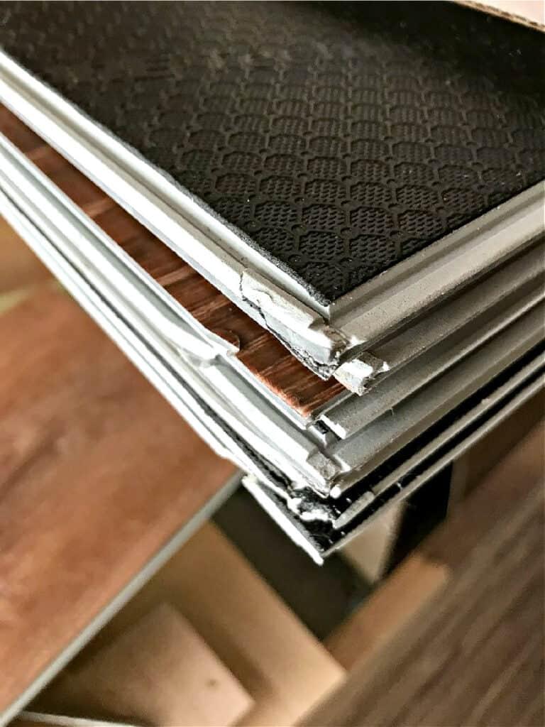 stack of broken vinyl floor planks